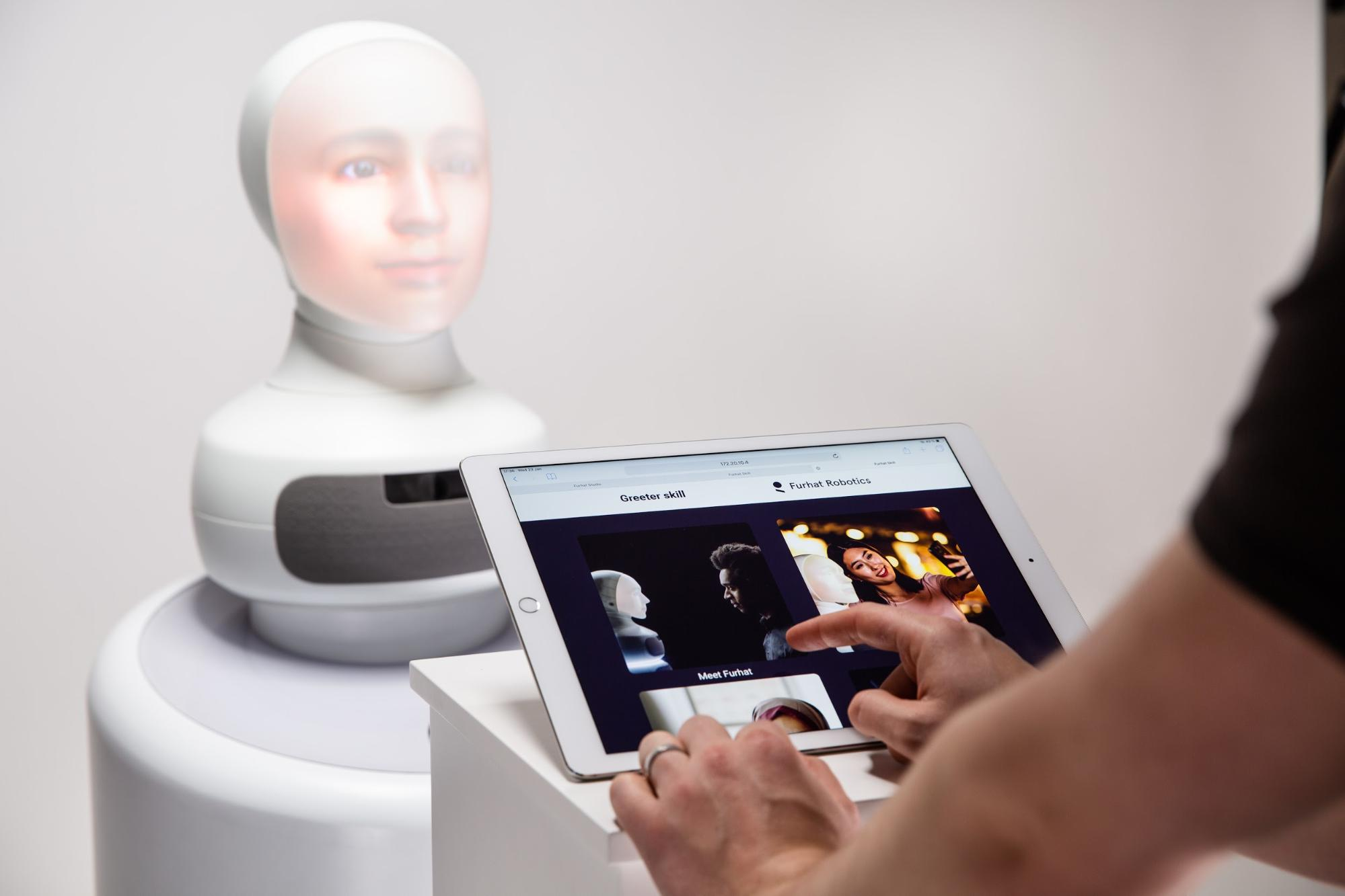 Should social robots have touch screens?